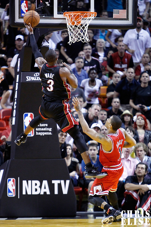 06 March 2011: Miami Heat shooting guard Dwyane Wade (3) goes for the layup past Chicago Bulls shooting guard Kyle Korver (26) during the Chicago Bulls 87-86 victory over the Miami Heat at the AmericanAirlines Arena, Miami, Florida, USA.