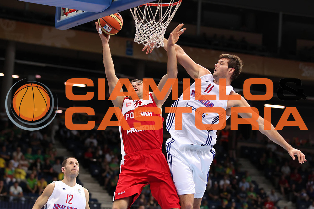 DESCRIZIONE : Panevezys Lithuania Lituania Eurobasket Men 2011 Preliminary Round Inghilterra Polonia Great Britain Poland<br /> GIOCATORE : Adam Hrycaniuk <br /> SQUADRA : Polonia Poland<br /> EVENTO : Eurobasket Men 2011<br /> GARA : Inghilterra Polonia Great Britain Poland<br /> DATA : 05/09/2011 <br /> CATEGORIA : tiro shot<br /> SPORT : Pallacanestro <br /> AUTORE : Agenzia Ciamillo-Castoria/ElioCastoria<br /> Galleria : Eurobasket Men 2011 <br /> Fotonotizia : Panevezys Lithuania Lituania Eurobasket Men 2011 Preliminary Round Inghilterra Polonia Great Britain Poland<br /> Predefinita :