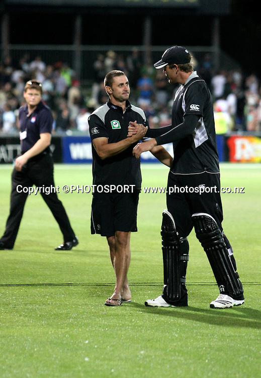 Peter Ingram helps a padded up but injured Jacob Oram from the field after the win. New Zealand Black Caps v Australia. 1st ODI, Chappell-Hadlee Trophy Series. McLean Park, Napier. Wednesday 03 March 2010  Photo: John Cowpland/PHOTOSPORT