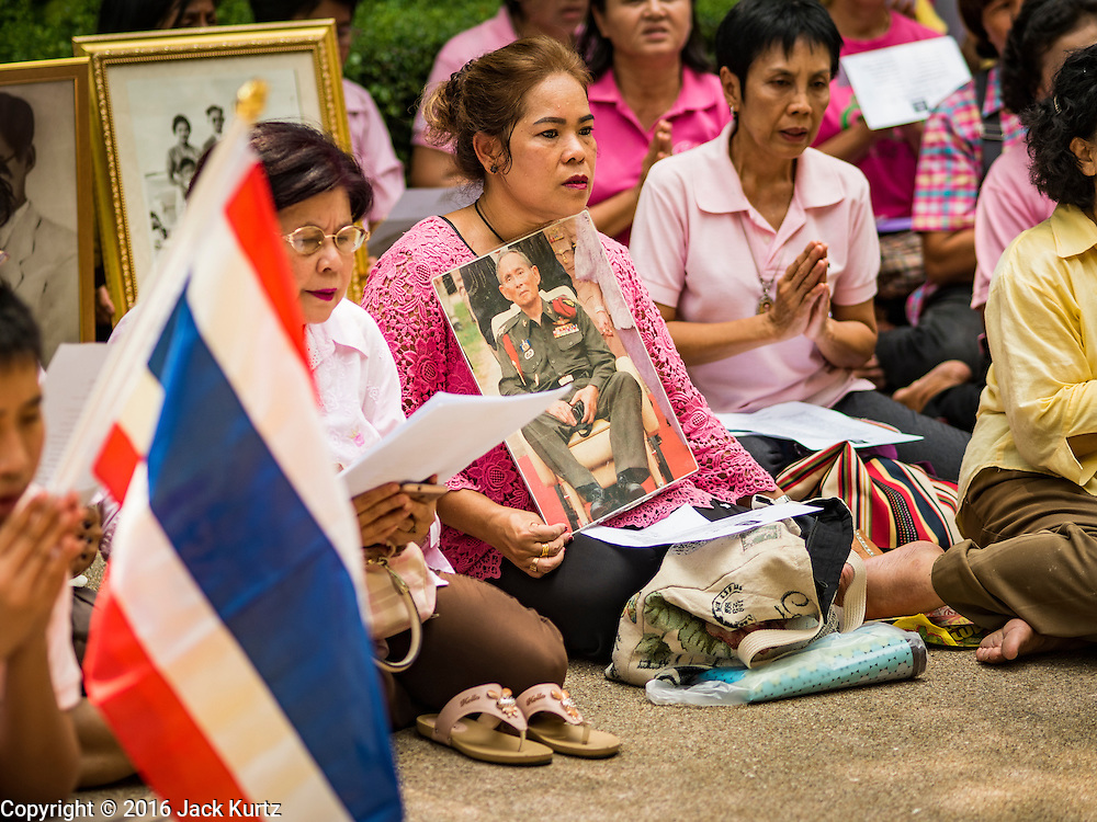 13 OCTOBER 2016 - BANGKOK, THAILAND:   Women pray for Bhumibol Adulyadej, the King of Thailand, at a lily pond at Siriraj Hospital Thursday morning before the King's death was announced. Thousands of people came to the hospital to pray for the beloved monarch. Bhumibol Adulyadej, the King of Thailand, died at Siriraj Hospital in Bangkok Wednesday, October 13, 2016. Bhumibol Adulyadej, 5 December 1927 – 13 October 2016, was the ninth monarch of Thailand from the Chakri Dynasty and is known as Rama IX. He became King on June 9, 1946 and served as King of Thailand for 70 years, 126 days. He was, at the time of his death, the world's longest-serving head of state and the longest-reigning monarch in Thai history.      PHOTO BY JACK KURTZ