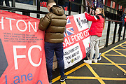 Salford City fan cub fixing the banner.  EFL Sky Bet League 2 match between Salford City and Macclesfield Town at the Peninsula Stadium, Salford, United Kingdom on 23 November 2019.