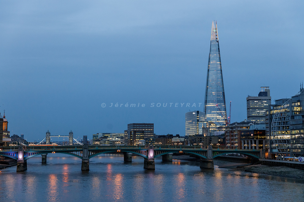 London, England, UK, June 15 2018 - Thames river and The Shard, tallest skyscrapers in Europe, at night.