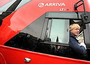 © Licensed to London News Pictures. 16/12/2011, London, UK.  BORIS JOHNSON sits in the drivers seat. The first bus designed specifically for London arrived in the capital today, carrying the Mayor of London BORIS JOHNSON. The bus design is based on the famous red route master buses with a rear platform for access. Photo credit : Stephen Simpson/LNP