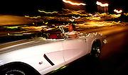 Cruising Speedway Boulevard, Tucson, Arizona, USA, in a 1962 Corvette.