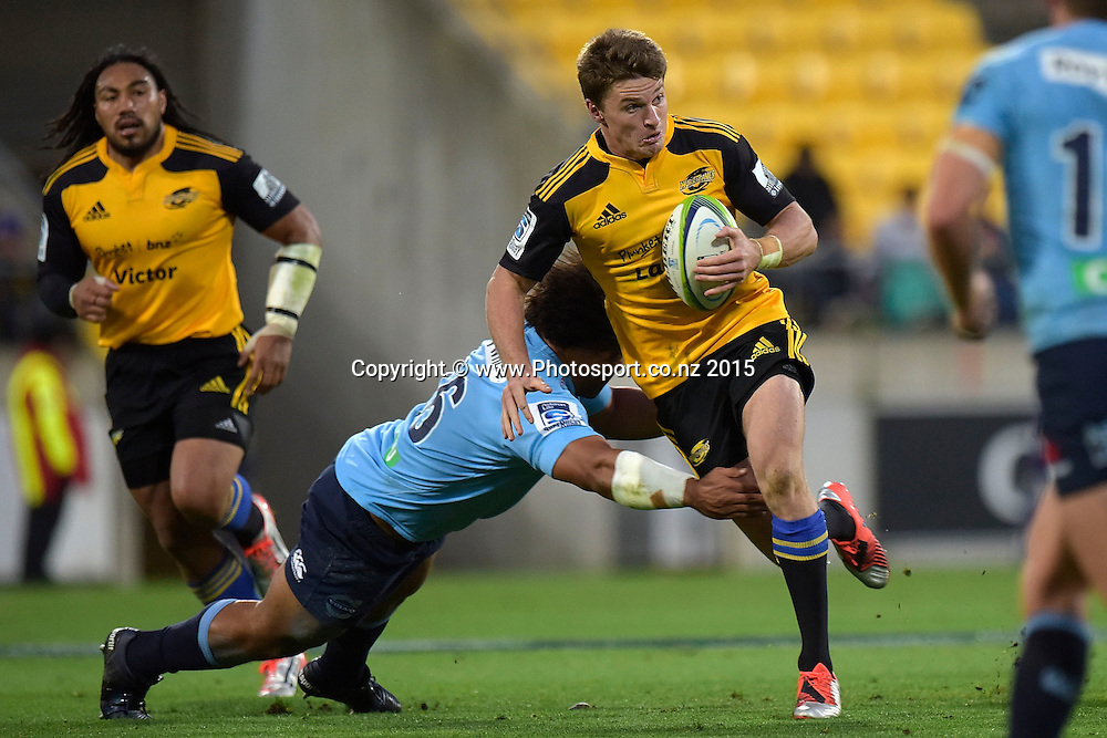 Hurricanes' fly-half Beauden Barrett (R is tackled by Waratahs' Tatafu Polota-Nau during the Super Rugby - Hurricanes v Waratahs rugby union match at the Westpac Stadium in Wellington on Saturday the 18th of April 2015. Photo by Marty Melville / www.Photosport.co.nz