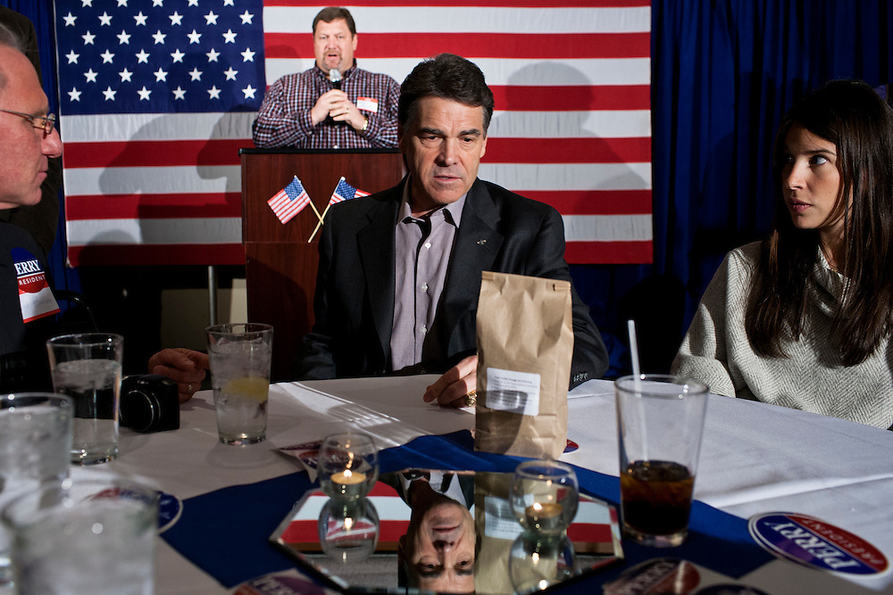 Republican presidential candidate Rick Perry attends a Cerro Gordo County GOP Fundraiser on Friday, December 30, 2011 in Mason City, IA.