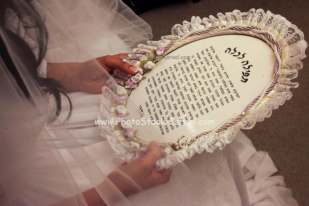 Bride's prayer. A bride on her wedding night reads a special prayer