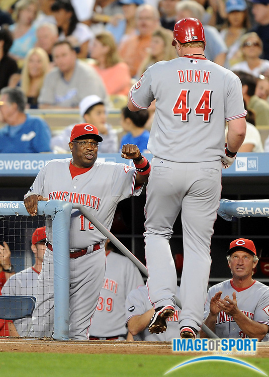 May 19, 2008; Los Angeles, CA, USA;  Cincinnati Reds left fielder Adam Dunn (44) is greeted by manager Dusty Baker after hitting a two-run home run in the third inning against the Los Angeles Dodgers at Dodger Stadium.