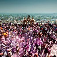 Courtyard of Radha Rani temple. People celebrating Holi. Braj ki Holi