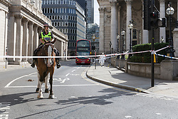 © Licensed to London News Pictures. 24/07/2016. LONDON, UK.  Police cordon at Threadneedle Street. A 26 year old man was stabbed outside Bank Tube station in Threadneedle Street near the Bank of England in the early hours of this morning. The man is then reported to have staggered onto the N242 bus, horrifying passengers. Ambulance and police emergency services were then called.  Photo credit: Vickie Flores/LNP