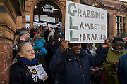 Local campaigners gather outside while protesting on the steps of Carnegie Library in Herne Hill, south London while occupiers remain inside the premises on day 5 of its occupation, 4th April 2016. The angry local community in the south London borough have occupied their important resource for learning and social hub for the weekend. After a long campaign by locals, Lambeth have gone ahead and closed the library's doors for the last time because they say, cuts to their budget mean millions must be saved. A gym will replace the working library and while some of the 20,000 books on shelves will remain, no librarians will be present to administer it.