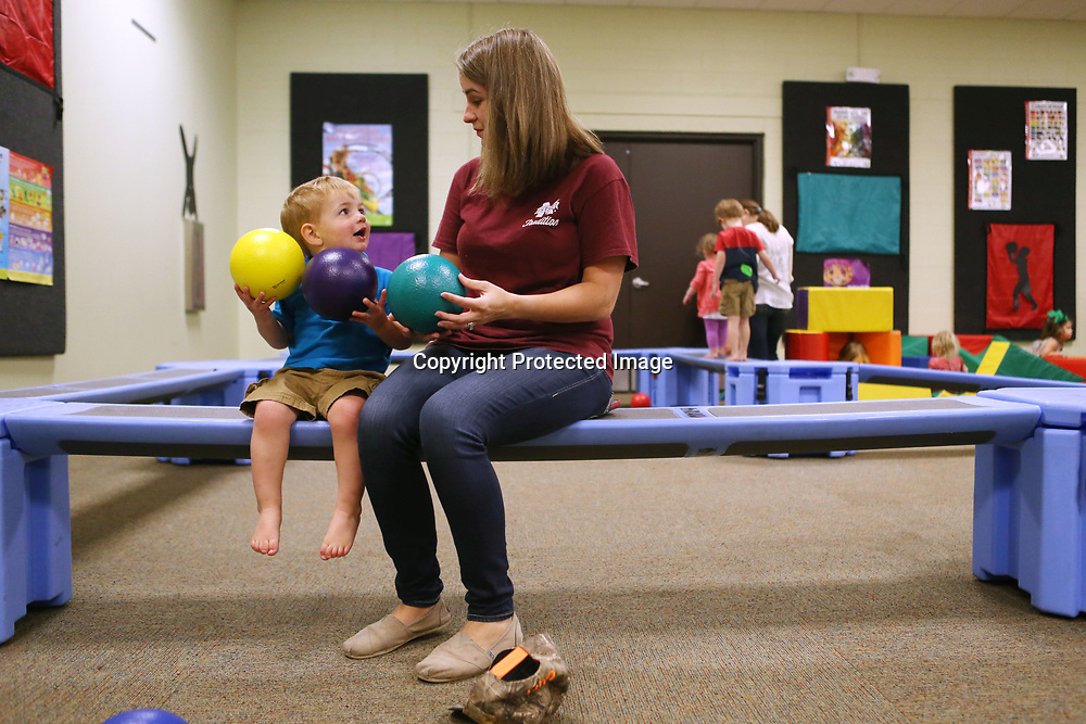 "Rochelle Sanders and her son Curt, 2, play in the Zoom Room Monday morning during the ""We Love Our Moms!"" Hip Hoppers session at Healthworks!. Hip Hoppers are preschool age kids that meet twice a month year round."