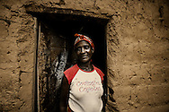 Tchikuteny?s wife at her home, in the village. In Angola?s Namibe desert, at Giraul, in the Namibe province, Tchikuteny, from the Mucubal tribe, is the leader of a big family, maybe the biggest family in the world.<br /> He is the chief leader, the manager and responsible for the entire village. <br /> In his village, Tchikuteny lives nowadays with most of his big family, his 33 wives, that were once 43, but 10 left the village, and most of their descendants.<br /> Tchikuteny maintains the registry of all the new-borns, totalizing 154 sons, and his grandsons, that are around 60. Nowadays, 4 new babies are on the way, and 3 great grand children were born recently.<br /> Huge harmony, love and respect transpire in the village atmosphere. The sense of a community is the pillar of their sustainability and sustenance and their autonomy depends prominently on cattle and agriculture that is made by the villagers. Nevertheless, Tchikuteny village is in close connection with their surrounding communities. Children attend Giraul School and there is proximity and relations with the extended family that lives in the surroundings.<br /> Being the spiritual leader of the community, Tchikuteny is also responsible for the weekly religious works that happens in the village church. <br /> This big family opened his doors to share with us their daily lives.