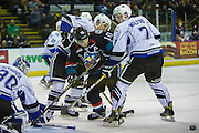 KELOWNA, CANADA - OCTOBER 26:  Nick Merkley #10 of the Kelowna Rockets fights Scott Walford #7 of the Victoria Royals and Ralph Jarratt #4 of the Victoria Royals for the puck at the Kelowna Rockets game on October 26, 2016 at Prospera Place in Kelowna, British Columbia, Canada.  (Photo By Cindy Rogers/Nyasa Photography,  *** Local Caption ***  Griffen Outhouse #30 of the Victoria Royals