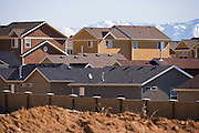 Rows of rooftops in shades of gray and brown in a newly developed subdivision