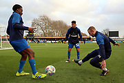 AFC Wimbledon fitness coach Jason Moriarty warming up with AFC Wimbledon attacker Zach Robinson (29) and AFC Wimbledon Husuyin Biler (32) during the EFL Sky Bet League 1 match between AFC Wimbledon and Doncaster Rovers at the Cherry Red Records Stadium, Kingston, England on 14 December 2019.