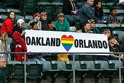 OAKLAND, CA - JUNE 14:  Oakland Athletics fans hold up a sign in remembrance of victims of the Orlando terror attack on Pride Night before the game against the Texas Rangers at the Oakland Coliseum on June 14, 2016 in Oakland, California. The Texas Rangers defeated the Oakland Athletics 10-6. (Photo by Jason O. Watson/Getty Images) *** Local Caption ***