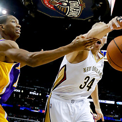Nov 8, 2013; New Orleans, LA, USA;  New Orleans Pelicans center Greg Stiemsma (34) and Los Angeles Lakers shooting guard Wesley Johnson (11) reach for a loose ball during the first quarter of a game at New Orleans Arena. Mandatory Credit: Derick E. Hingle-USA TODAY Sports