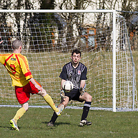Lifford's goalie Sean Hayes saves an attempt on goal by Avenue Utd's Barry Nugent