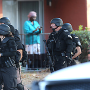 Law enforcement officers are seen as they search door to door for suspect Markeith Loyd at the Tzadik Brookside Apartments on January 9 2017 in Orlando, Florida. Loyd shot an Orlando Police officer earlier in the day at a local Walmart, the officer has since died.  (Alex Menendez via AP)