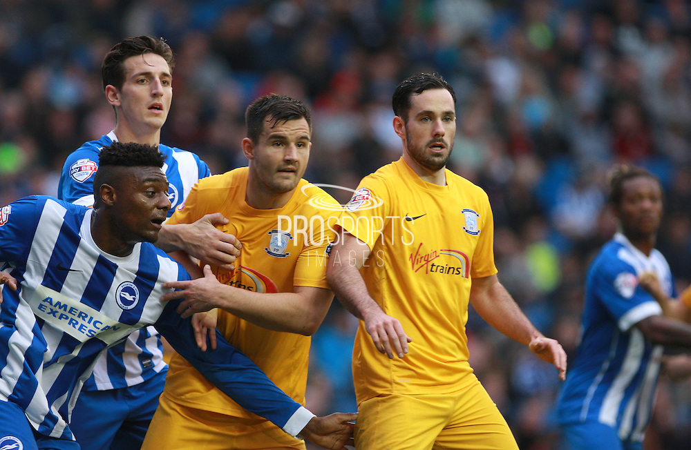 Brighton central midfielder Rohan Ince and Brighton central defender Lewis Dunk jostle for space with Preston North End defender Bailey Wright & Preston North End defender Greg Cunningham during the Sky Bet Championship match between Brighton and Hove Albion and Preston North End at the American Express Community Stadium, Brighton and Hove, England on 24 October 2015. Photo by Bennett Dean.
