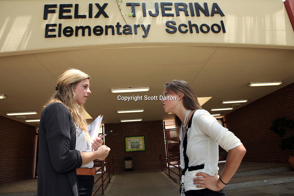 Julianne Carlson, right, a teacher with Teach For America, speaks with Lainey Sullivan, left, the School Operations Manager and also with Teach For America, outside of Tijerina Elementary School in Houston, TX on Friday July 9, 2010. (Photo/Scott Dalton)