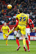 Nottingham Forest defender Jack Hobbs remains strong to get a header in to clear the danger during the Sky Bet Championship match between Charlton Athletic and Nottingham Forest at The Valley, London, England on 2 January 2016. Photo by Andy Walter.