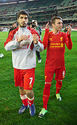 MELBOURNE, AUSTRALIA - Wednesday, July 24, 2013: Liverpool's Luis Suarez and Iago Aspas wave to the supporters after their 2-0 victory over Melbourne Victory during a preseason friendly match at the Melbourne Cricket Ground. (Pic by David Rawcliffe/Propaganda)