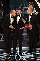 February 26, 2017 - Hollywood, California, U.S. - L-R: JORDAN HOROWITZ, JIMMY KIMMEL and Best Picture presenter WARREN BEATTY on stage, during the live telecast of the 89th Oscars. After, ''La La Land'' was named the winner. The cast were getting their Oscars, when, it was announced that ''Moonlight'' was the real winner. (Credit Image: © Mark Suban/A.M.P.A.S. via ZUMA Wire)