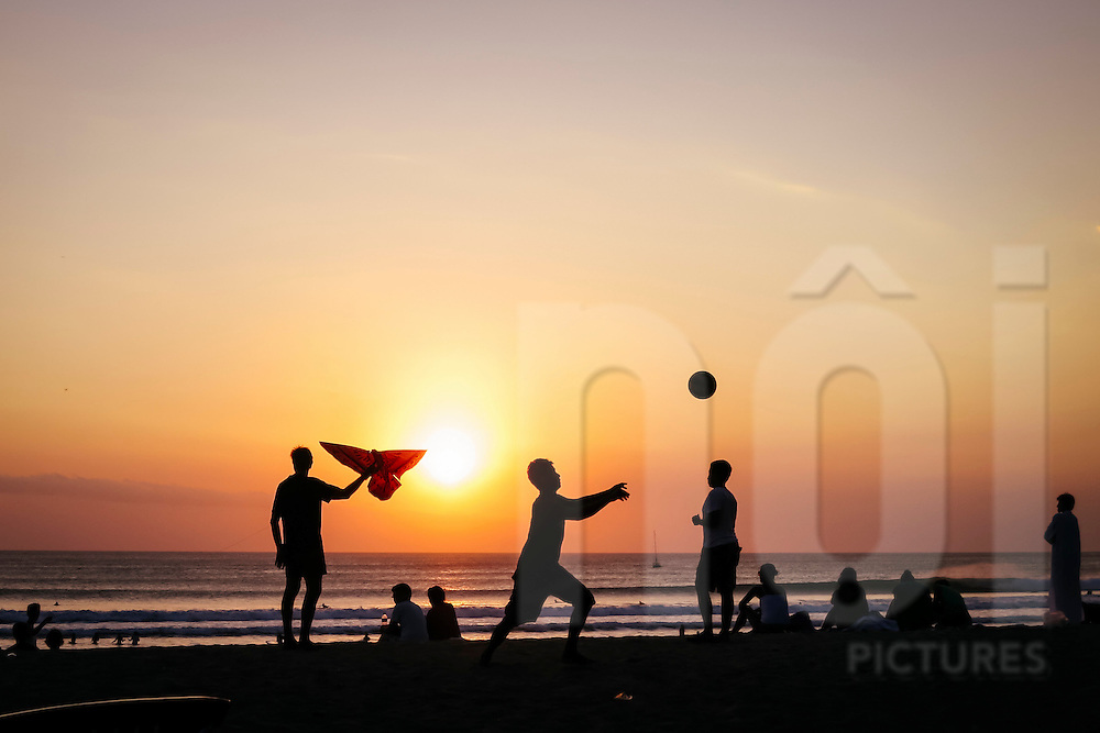 Leisure time for a group of people along Kuta Beach,  Bali, Indonesia, Southeast Asia