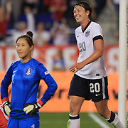 Abby Wambach, USA, celebrates her fourth goal of the game becoming the greatest goal scorer in international soccer. Wambach scored four goals during the U.S. Women's 5-0 victory over Korea Republic, friendly soccer match. The four goals brings her tally to 160 goals which eclipsed Mia Hamm's all-time goal record of 158 goals.  Red Bull Arena, Harrison, New Jersey. USA. 20th June 2013. Photo Tim Clayton