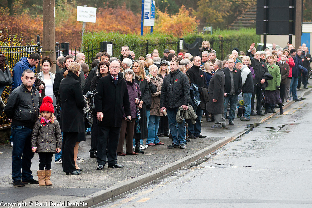 Local people waiting for the 2011  Remembrance Day Parade in Chapeltown Sheffield South Yorkshire...13 November 2011. Image © Paul David Drabble