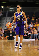 June 4, 2010; Phoenix, AZ, USA; Los Angeles Sparks guard Tisha Penicheiro dribbles the ball against the Phoenix Mercury during the first half at US Airways Center.  The Mercury defeated the Sparks 90-89.  Mandatory Credit: Jennifer Stewart-US PRESSWIRE