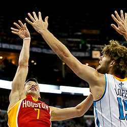 Jan 9, 2013; New Orleans, LA, USA; Houston Rockets point guard Jeremy Lin (7) shoots over New Orleans Hornets center Robin Lopez (15) during the second half of a game at the New Orleans Arena. The Hornets defeated the Rockets 88-79. Mandatory Credit: Derick E. Hingle-USA TODAY Sports