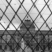 The distinctive glass pyramid of the Musee Du Louvre, a famous landmark and world renowned Museum and architectural masterpiece.  Paris, France, 28th February 2011 .
