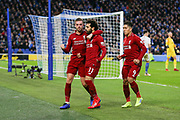 GOAL - 0-1 Liverpool striker Mohamed Salah (11) celebrates scoring from the penalty spot with Liverpool midfielder Jordan Henderson (14) and Liverpool striker Roberto Firmino (9) during the Premier League match between Brighton and Hove Albion and Liverpool at the American Express Community Stadium, Brighton and Hove, England on 12 January 2019.