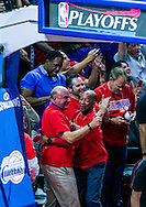 Los Angeles Clippers owner Steve Ballmer, left, celebrates after his team defeated San Antonio Spurs 111-109 during their first round NBA playoff game at Staples Center in Los Angeles, California on May 2, 2015.