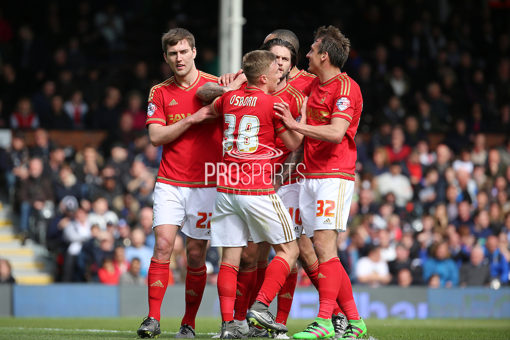 Nottingham Forest midfielder Henri Lansbury (10) celebrating scoring penalty with Nottingham Forest midfielder Robert Tesche (32) 0-2 during the Sky Bet Championship match between Fulham and Nottingham Forest at Craven Cottage, London, England on 23 April 2016. Photo by Matthew Redman.