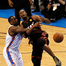 Jun 14, 2012; Oklahoma City, OK, USA;  Miami Heat power forward Chris Bosh (1) drives to the basket as Oklahoma City Thunder center Kendrick Perkins (5) defends during the first quarter of game two in the 2012 NBA Finals at Chesapeake Energy Arena. Mandatory Credit: Derick E. Hingle-US PRESSWIRE