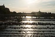 France. Paris. Seine river bridges.  Pedestrians on Solferino bridge on the Seine river