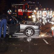 Ongeval met geleende BMW Naarderstraat Huizen.lekkage benzine, schuim, cabrio, brandweer, politie