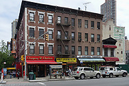 Chirping Chicken, Abbey Locksmith, Inc, Cascabel Taqueria restaurant and the Piermont Cleaners on 2nd Ave and 81st street looking east