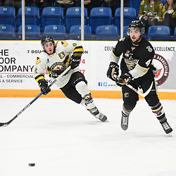 TRENTON, ON  - MAY 2,  2017: Canadian Junior Hockey League, Central Canadian Jr. &quot;A&quot; Championship. The Dudley Hewitt Cup. Game 2 between Powassan Voodoos and the Trenton Golden Hawks. Gary Mantz #9 of the Powassan Voodoos and Chays Ruddy #4 of the Trenton Golden Hawks pursue the play during the first period.<br /> (Photo by Andy Corneau / OJHL Images)