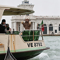 VENICE, ITALY - FEBRUARY 04:  A  waterbus and a gondola are seen on the Grand Canal facing Punta della Dogana where amodel of a giant bull - the 2012 edition symbol of Venice Carnival -has been placed on February 4, 2012 in Venice, Italy. The Carnival of Venice (Carnevale di Venezia) is an annual festival and starts 40 days before Easter and ends on Shrove Tuesday ( Martedì Grasso).  (Photo by Marco Secchi/Getty Images)