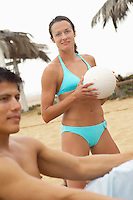 Woman in Bikini Holding Volleyball