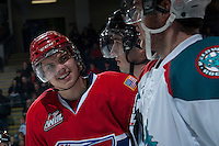 KELOWNA, CANADA -JANUARY 29: Jeremy McIntosh D #4 of the Spokane Chiefs exchanges words with a player of the Kelowna Rockets during first period on January 29, 2014 at Prospera Place in Kelowna, British Columbia, Canada.   (Photo by Marissa Baecker/Getty Images)  *** Local Caption *** Jeremy McIntosh;