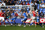 Garry O'Connor (9) of Barnsley shoots but is blocked by Chris Armstrong (33) of Reading during the Npower Championship match between Reading and Barnsley on Saturday 25th September 2010 at the Madejski Stadium, Reading, UK. (Photo by Andrew Tobin/Focus Images)
