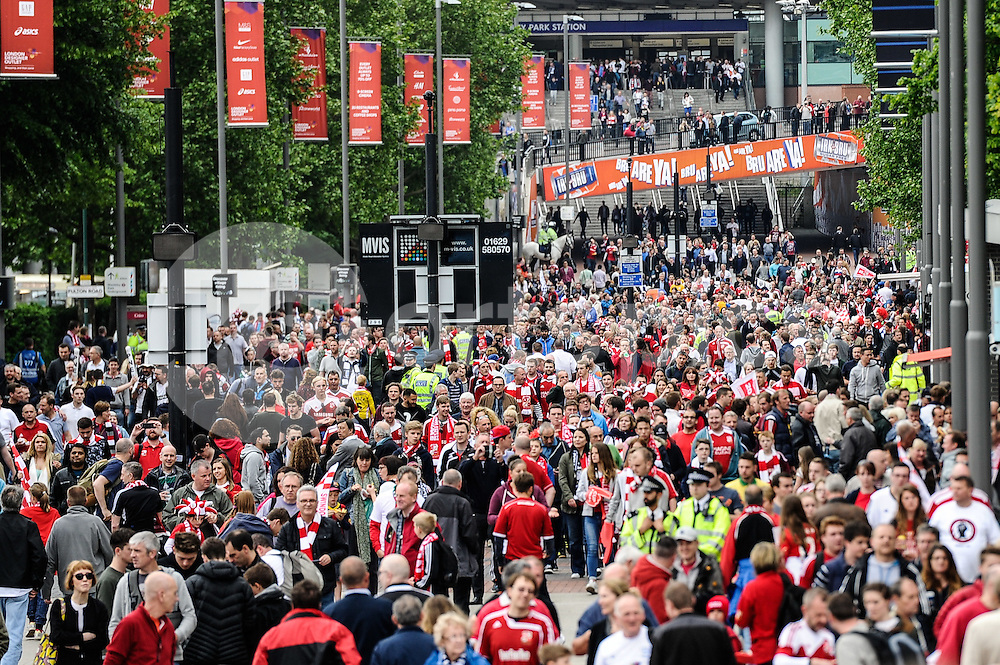 The crowd of supporters approach the Wembley Stadium  before the Sky Bet League 1 Play-Off Final match between Preston North End and Swindon Town at Wembley Stadium, London, England on 24 May 2015. Photo by Salvio Calabrese.