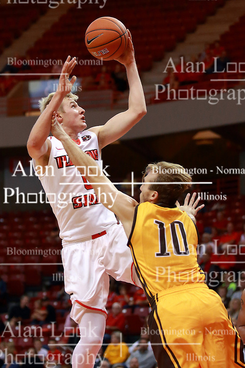 05 November 2016:   Isaac Gassman(0) shoots while being lunged at by Grant Meyer during an NCAA  mens basketball game where the Quincy Hawks lost to the Illinois State Redbirds in an exhibition game at Redbird Arena, Normal IL