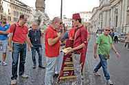Roma 6 Agosto 2014<br /> Sono tornati per pochi minuti i dehors a Piazza Navona. I titolari dei ristoranti  hanno deciso di alzare le saracinesche e ripristinare gli spazi esterni, ma posizionando i tavolini nel rispetto dei limiti imposti dalle concessioni del comune di Roma. Ma gli agenti della municipale li hanno bloccati: &quot;Non sono autorizzati&quot;. Agente della polizia municipale ferma un  cameriere di un ristorante libanese che  pubblicizza il suo ristorante in Piazza Navona.<br /> Rome August 6, 2014 <br /> They came back for a few minutes the dehors in the Piazza Navona. The owners of the restaurants have decided to raise the  rolling shutter and restore the dehors, but by placing the tables within the limits imposed by the concessions of the city of Rome. But the agents of the municipal blocking them: &quot;They are not unauthorised &quot;. Municipal police officer stops a waiter of  a Lebanese restaurant that advertises his restaurant in Piazza Navona.